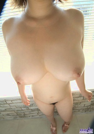Japanese solo woman Hanano Nono fondles her huge boobs in the nude
