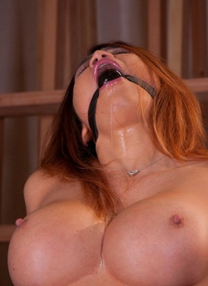 Busty Asian chick Mia Lelani is machine fucked while ballgagged and limited