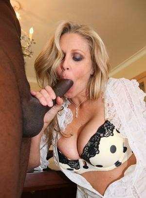 Molten towheaded Julia Ann licks black cock & spreads long legs for anal invasion