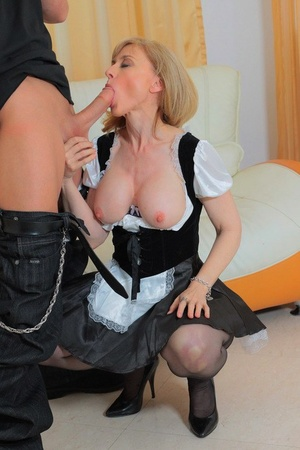 Mature pornstar Nina Hartley goes pussy to throat in a maid's uniform