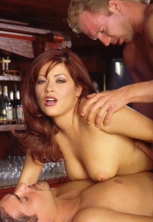 Stunning redhead Misty hooks up in 3 way for double penetration at the bar