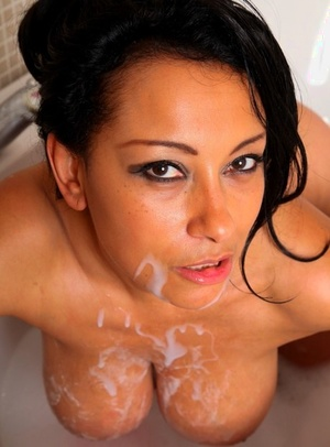 Naked mature woman Danica Collins shows her mounds and twat while bathing