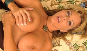 Big titted amateur Amber Lynn Bach fingers her pussy with manicured nails