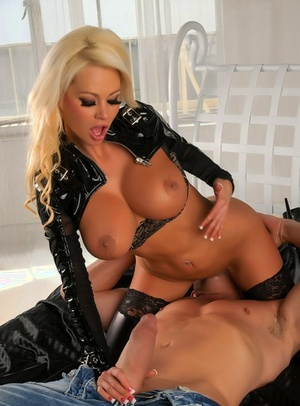 Beautiful blonde doll Nikita Von James rides a cock in latex attires