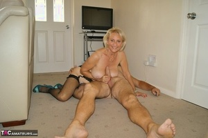 Older woman takes off her glasses and clothes before finger fucking