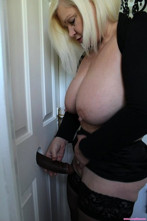 Naughty nan Lacey Starr sucks a BBC via gloryhole before nailing