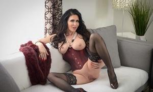 Brunette pornstar Jessica Jaymes licks a dick after hook-up in harness and hoisery