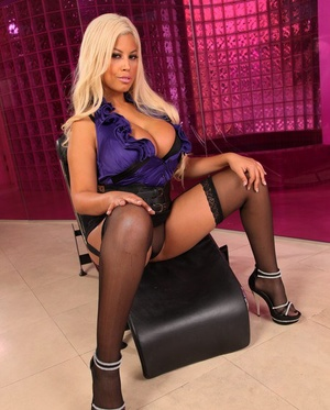 Stunning blonde Bridgette B reveals her massive thick boobs posing in high heels