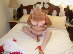 Fat old woman Grandma Libby bares her tan lined tits and g-spot on her bed
