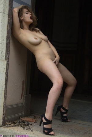 Solo model Lottii Rose casually gets naked outside an old monastery