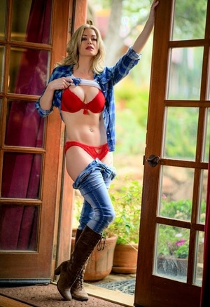 Sexy blonde releases her hot bootie from panties and denim in calf high boots