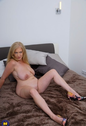 British granny with big naturals rails on top of her toy boy on bed
