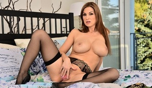 Ample boobed solo girl Carol Gold sticks a dildo in her landing strip cootchie