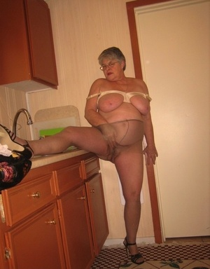 Old woman Girdle Queen disrobes to tights in her kitchen