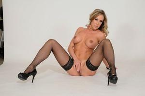 Big-boobed mature woman Brandi Love goes p2m in black stockings