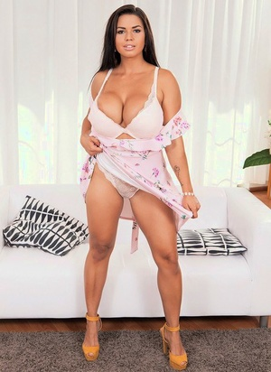 Brunette chick Chloe Lamoure uncovers her big baps and ass as she disrobes