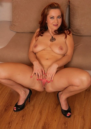 Sexy mature woman Jessica Red unwraps before finger screwing in high-heeled slippers