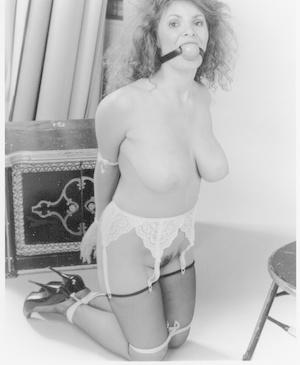 Attractive big boobed MILF in stockings got bound in kinky vintage BDSM scene