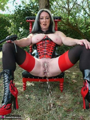Kinky Gothic MILF Mary Bitch wearing a enormous black strapon & pissing outdoors