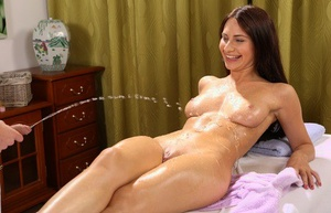 Brunette GF Lana Ray pissing in a glass while fingering her horny pussy