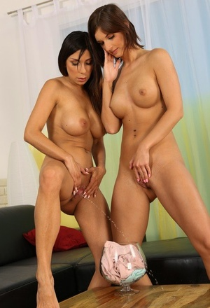 Sapphic girls Jenifer Jane & Rachel Evans kiss while playing piss ganes