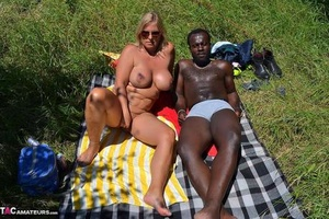 Huge-boobed blonde slut Chrissy has her pierced pussy exposed on interracial picnic