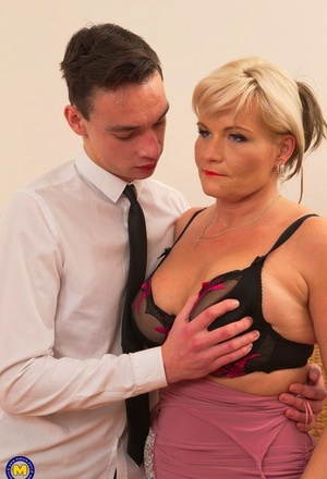 Stunning mature lady with blonde hair hooks up with her toy boy during her travels