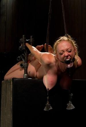 Dee Williams experiences hardcore Bondage & Discipline with metal bondage and humiliation