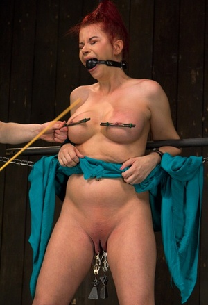 Vulnerable redhead Sarah Blake is hooded and tortured before being masturbated
