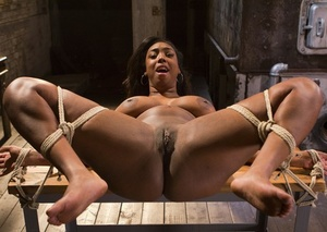 Ebony chick Lisa Tiffian is restrained with rope for the delight of white men