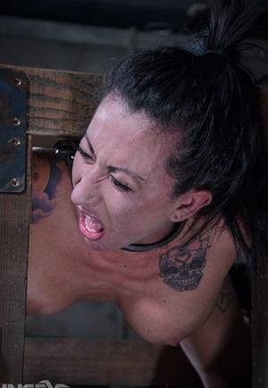 Secretary Lily Lane finds herself locked up and restrained in a dungeon
