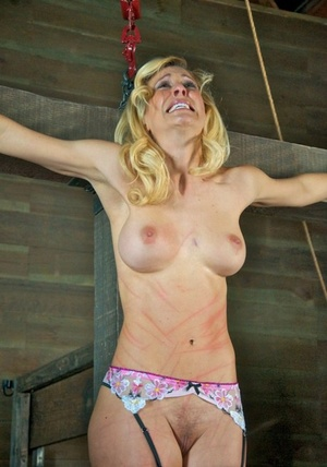 Busty sub hung on cross and tortured with tongue clip & other harsh instruments