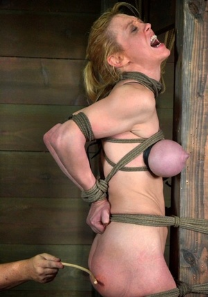 Busty female marionette Darling got tied up and tortured by a dominant couple