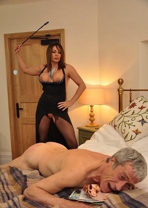 Mistress Carly hits her masculine slave's ass with crop and makes him lick her out