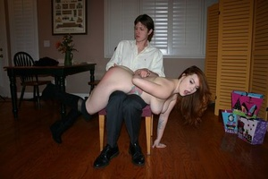 Naked female Summer Hart has her ass turned red during bare hand spanking