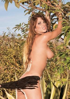 Mummy pornstar Karina gets spanked outdoors in horny BDSM action