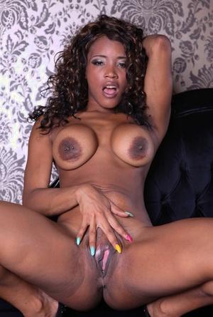 Ebony princess Kiki Minaj shows off her fake tits and her big succulent bootie