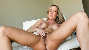 Large ass blonde milf babe Brandi masturbating her pussy untill splatter