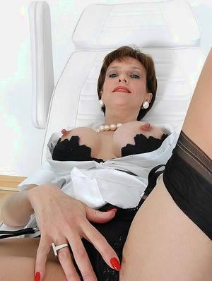 Mature fetish lady in stockings teasing her slit through her sexy panties