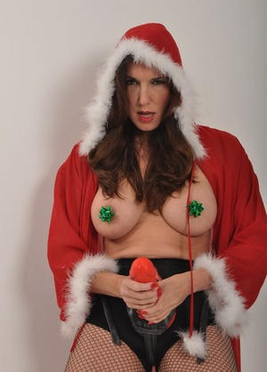 Older lady sports a strapon cock in stockings and Xmas clothing