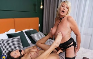 Mature lady ball gags a young girl prior to them having lesbian sex