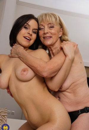 Mature lady lives out her lesbian sex desires with a young girl