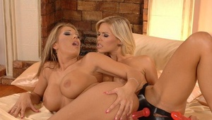 Steamy lesbians Wivian & Candy Strenuous liquidate latex attire before strapon penetrating