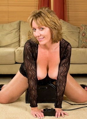 Older dame Samantha Stone parks her horny cunt atop a Sybian sex machine