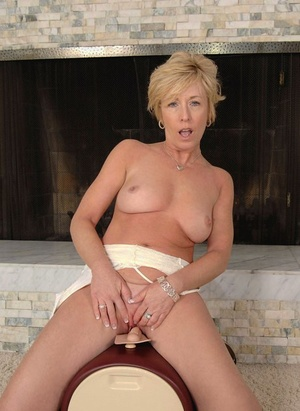 Wonderful older lady undresses prior to riding her Sybian sex machine