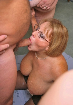 Big titted amateur Curvaceous Claire talks on cell as she begins a blowbang session