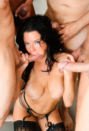 Dark haired Veronica Avluv gags on big cock & gets cum covered in hot blowbang