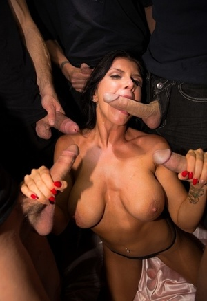 Big titted pornstar Romi Rain gets gangbanged on pinkish satin sheets
