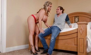 Chesty blonde mom Amber Lynn Bach takes a cumshot on huge knockers