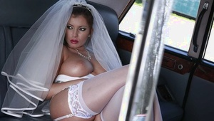 Sassy bride exposing her ample melons and clean-shaven pussy outdoor